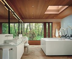 Picture Window, Skylight and Mirrors bring the outdoors into this Luxury Bath...