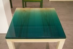 A thick coat of resin provides a tactile tabletop on one of Japanese architect Jo Nagasaka's new pigmented resin pieces for Brit brand Established & Sons.