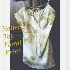 Green Spaghetti Strap Top  Spaghetti strap top, light green w/darker shades of green flowers. Asymmetrical hem. Very feminine top. Only worn once. Excellent condition, no stains, holes or rips. I removed the size tag but it's a Medium.  ⚡ Price is firm unless bundled ⚡  * Bundle with other items and save on shipping.  * Sorry, no PayPal or trades * Smoke-free home Tops