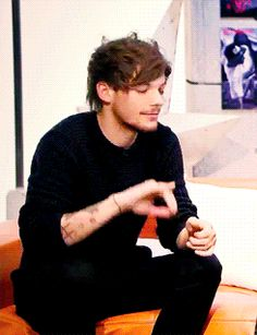 11 times Louis Tomlinson was actually a little kitty   - Sugarscape.com