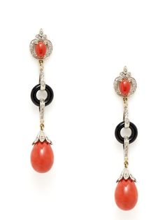 14K yellow gold, bonded silver, and round cut champagne diamond linear drop earrings with oval coral cabochon, onyx open circle, and coral briolette drop details    Total onyx and coral carat weight is 26.50  Total champagne diamond carat weight is 1.35  2.7 inches long  0.45 inches wide  By Amrapali at Gilt