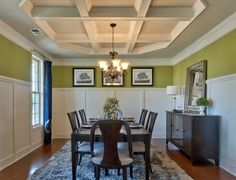 Loving the bright green against the white wainscoting in this formal dining room! #DRHorton #SouthCarolina
