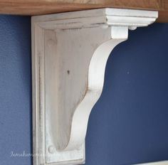 How to distress corbels for farmhouse or open shelving Home Depot corbel shelf bracket, first stained with Minwax Early American then painted white and distressed, shelves are utility boats from Home Depot cut in half also stained with early American by Minwax