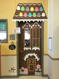 It turned out amazing! Christmas Door Decorating Contest, Office Christmas Decorations, Christmas Classroom Door, Preschool Christmas, Candy Land Christmas, Christmas Fun, Preschool Door Decorations, Cardboard Gingerbread House, School Doors