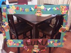 Created this photo booth frame out of cardboard and acrylic paints. Adding on some luau decorations.