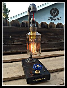 Who doesnt like good ol Jack? From Fifty1st is yet another fine table lamp for your home. Original design, reclaimed wood base, functional water valve dimmer switch and of course a reclaimed Jack Daniels bottle. Quality is all you get over here at Fifty1st. Youre welcome! Features: •