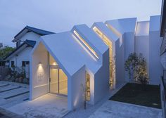 Clinic by Hkl Studio house-shaped to make patients feel at home