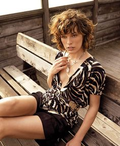 Milla Jovovich hair inspiration: shaggy bob with bangs. I like her messy/curly style.