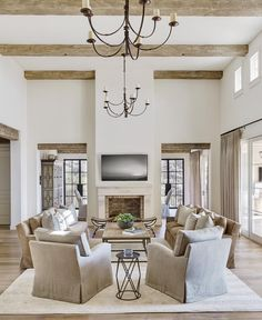 Elegant Hampton's style in soothing neutrals. Check out our range of chandeliers to get the look!