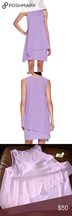 """London Style Collection  Purple Dress Size 16P London Style Collection  Purple Dress Size 16P 🌸The lovely asymmetric hem on our sleeveless sheath dress adds a fun twist to this already-feminine look.  roundneck sleeveless back zip and button 35½"""" length from shoulder polyester lining polyester/spandex machine wash, line dry🌸 New With tags 🌸 Retail$72 london Style Dresses"""