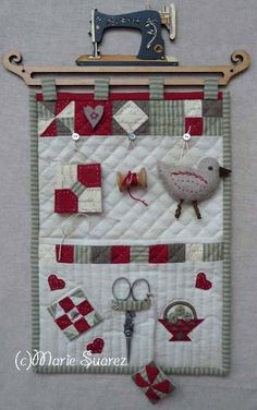 Note the scissors are real - a neat way to feature a pair of vintage scissors.  Love it especially the hanging shelf for the quilt.  Nice how they added a sewing machine.  Great for sewing room decor.
