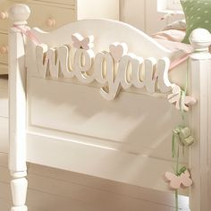 Could probably get wood letters at craft store and put something like this together.  Adorable for little girl! :)