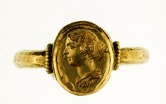 """""""Gold finger-ring, female portrait bust, with hair waved at the sides, and done up in a knot behind Roman, ca. 150 """""""