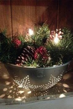A colander is turned beautiful holiday decor with winter greenery and berries...some led lighting gives a beautiful glow!