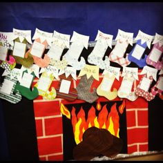 Fireplace bulletin board - Genious! Lines are made using masking tape to achieve straight lines! #Christmas #Stockings #Teacher #BulletinBoard #Fireplace #Kindergarten #DIY #Kids #Craft