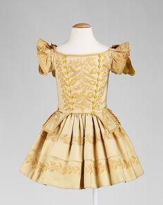 Dress - Dress Date: ca. 1855 Culture: American Medium: wool, silk Dimensions: Length at CB (a): 21 in. (53.3 cm) Length at CB (b): 14 in. (35.6 cm) Credit Line: Brooklyn Museum Costume Collection at The Metropolitan Museum of Art, Gift of the Brooklyn Museum, 2009; Gift of Miss F. P. Weiss, 1948