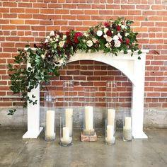 Gorgeous Wedding Alter! #experienceEBR #wedding #weddingday #bride  #bridal #weddingdesign  #weddingstyle #details #dreamwedding #weddinginspo #florals #wedding #florals #gardenroses #mantle #fireplace #candles
