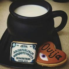 Love the mug! I wouldn't do these cookies (the ouija board is too much work for a cookie and also, I avoid ouija boards; I don't think they're a toy), but I think a pumpkin, a candy corn or a ghost would be cute!