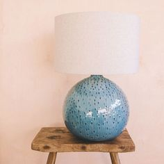 Crafted from ceramic with a blue glaze finish and unique dot texture, this round statement lamp is complete with a natural linen shade that will perfectly suit any neutral interior style. Blue Glass Vase, Tall Lamps, Room Lamp, Desk Lamp, Ceramic Table Lamps, Lamp Bases, Home Interior, Lamp Light, Lights