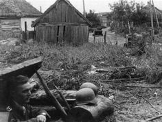 A rare view of German dugout inside the village next to the road.
