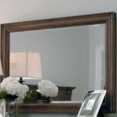 "Wall mirror with a wood frame.   Product: Wall mirrorConstruction Material: Oak wood and mirrored glassColor: WoodstoneDimensions: 32"" H x 46"" W x 2"" D"