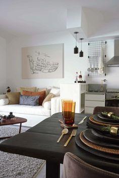 La transición de la cocina al living en un departamento de 47 m2 bien pensados por Design Home Gifts en Estilo Pilar.