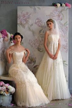 I'm in love with the dress on the left. It is absolutely breathtaking. Very classic looking.