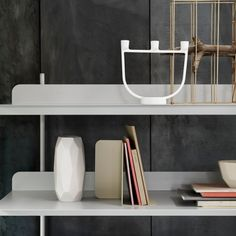 "The light, minimalist Compile configurable metal shelving system from Danish design firm Muuto. The ""office furniture"" feel would fit well in an industrial decor scheme...or a home office."