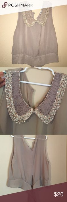 Beautiful crop top ❤️ Beautiful crop top with a mix of sequins and pearls embroidering the collar. Has two ribbons in the back used for tying to make more fitted. Would describe as a tan color. Only problem is the hook is broken in the back on the top. Shown in last picture. If you're interested and would like to see how it looks on, just leave a comment 😊 Bundle Discount! Bui yah kah Tops Crop Tops