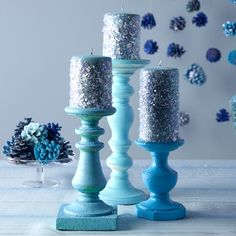 Add some sparkle to your soirée with these glitter candles. Paint sides of candles with glue and roll in glitter.