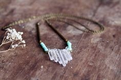 This piece is made from raw crystal quartz points, vintage brass bars and vintage glass turquoise beads.