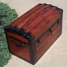 I have a wooden trunk similar to this, mine looks smaller maybe a child's trunk