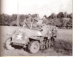A former 2nd Panzer Division sdkfz251 in US hands.