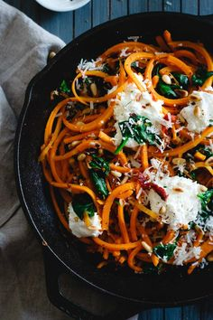 These garlicky butternut squash noodles are tossed with wilted spinach, sun-dried tomatoes, toasted pine nuts and dollops of fresh ricotta and parmesan for a wintry, one-pan, comforting vegetarian meal.