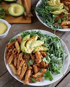 Spinach side salad with tomato pasta + avocado