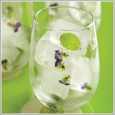 Directions:    Fill ice cube trays one-third full with distilled water    Freeze for one hour then add small flowers or mint leaves    Add more water and freeze all the way