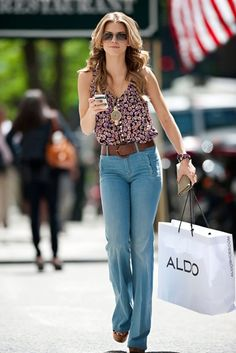 I would love to have whatever is in her Aldo bag!
