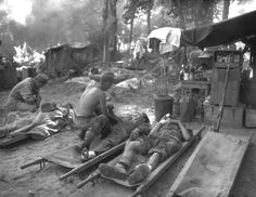 Description of  November 12, 1944: U.S. medics are seen as they treat wounded comrades at an portable surgical unit during the 36th Division's drive on Pinwe, Burma. (AP Photo)