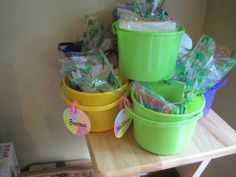 Treat bags for beach birthday party were in beach buckets. Included in them were goldfish crackers, sunglasses and a beach ball.
