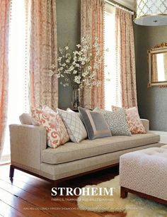 Living room decor. Like the peachy pink curtains against grey wall and the tiny white flowers.