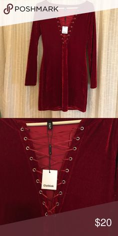 Red long sleeved velvet dress Beautiful dark red velvet dress with lace up detailing in the front. Size large and fits like a glove. Makes the girls look amazing:) Clothink Dresses Long Sleeve