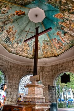 ...have a picture taken in front of the historical Magellan's Cross.