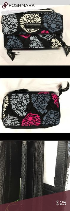 Vera Bradley Northern Lights All in One Crossbody Vera Bradley Northern Lights All in One Crossbody and Wristlet for iPhone 6+ NWT! It has a long removable strap and removable wristlet strap. It has a front pocket with a magnetic flap big enough to hold your iPhone 6+. There are two zippered compartments, one with two slip in pockets and a zippered coin purse and the other with a bill holder, 8 credit card slots, and a clear id window. This comes from a smoke free home! Vera Bradley Bags…