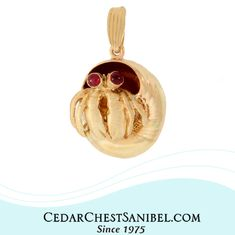 Peekaboo! 🦀  14Kt Gold Hermit Crab with Ruby Eyes inside a Moonsnail Shell Pendant .   #ShopOnSanibel #SanibelIsland #HermitCrab #SeaLifeJewelry