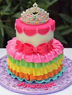 Rainbow princess cake with edible gumpaste crown. Banana walnut cake...