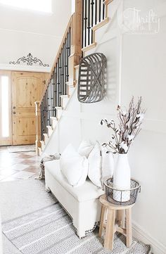 Modern farmhouse entryway decor and decorating ideas. White and neutral two story entryway