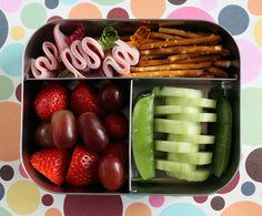 strips of deli ham on decorative picks, pretzel sticks, strawberries, grapes, snap peas and cucumber slices #projectlunchbox