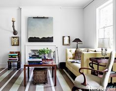"""To add visual interest to his Alabama living room, architect Bill Ingram painted a pattern of thick and narrow stripes over the stained wood floor. """"It jazzes everything up,"""" he says. The Tatum sofa is from Lee Stanton Home.   - HouseBeautiful.com"""