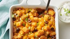 Tater Tots™ potatoes meet nachos in this fun, crowd-pleasing casserole! Layers of refried beans, ground beef, Tater Tots™ potatoes, salsa and cheese! Tater Tots, Tater Tot Casserole, Brunch Casserole, Chicken Casserole, Brazilian Chocolate, Orzo, Zucchini, Dinner With Ground Beef, Glass Baking Dish