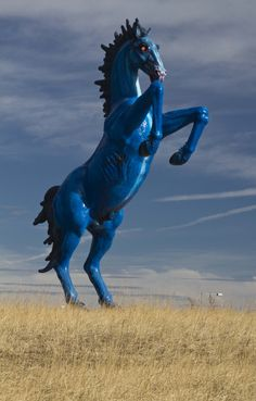 """Known as """"Blucifer"""" """"DIAblo""""  Blue Mustang by Luis Jiménez a 32' sculpture with glowing red eyes. This sculpture killed the artist. Some people are terrified by it. Located at the Denver International Airport.   via iplitigator.huschblackwell.com"""